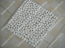 White pebble tiles on net