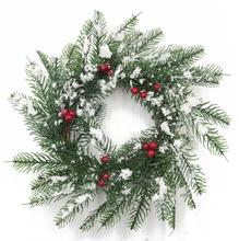 Christmas tree wreath/candle ring with artificial snow in the door