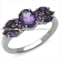 Astonishingly lovely sterling silver ring with deep violet colored amethyst gemstones, designed to impeccable beauty!!