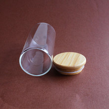 OEM 2.17 Inch Diameter Wide Mouth Glass Jar Bamboo Lid Borosilicate Glass Bottle 200 ml Glass Factory China