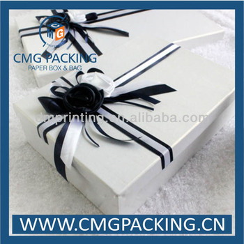 Cardboard wedding dress box with ribbon