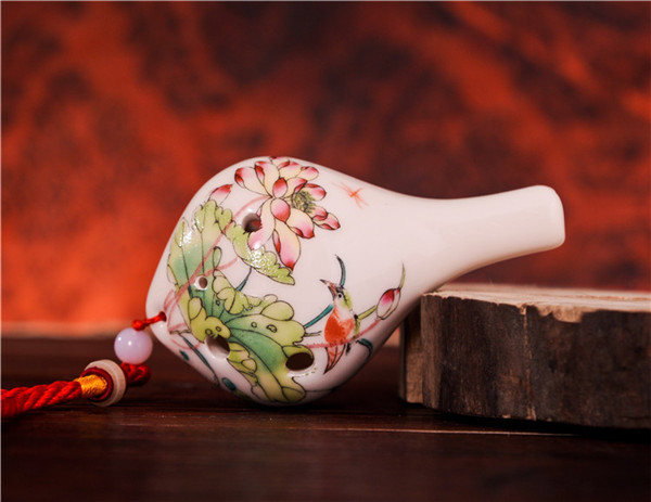 beauty hand drawing flower pictures on pottery ocarina