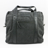 Durable multi-compartment canvas travel duffle bag with leather trim