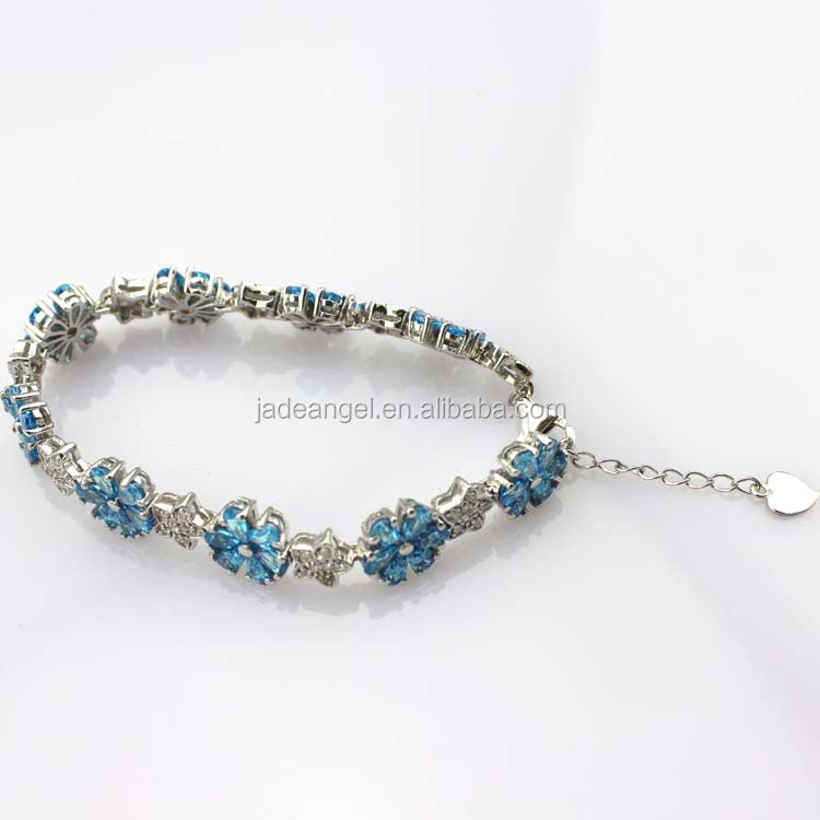 Sterling Silver Blue Topaz Link Flower Tennis Bracelet with CZ Diamonds