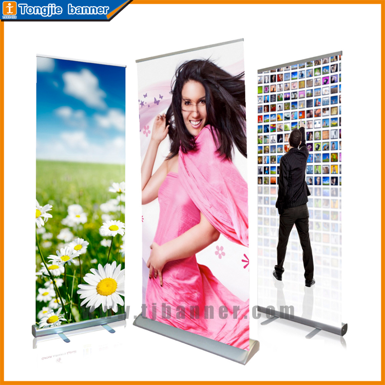 Spring roll up banner, pull up stand