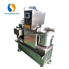Food processing machinery automatic small candy packaging wrapping machine/food packaging machine