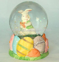 Resin cat hockey player inside snow globe