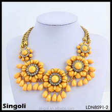 Yellow bead hibiscus flower gold braid chain necklace