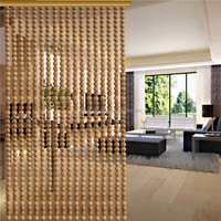 Wooden bead curtain on the wall for room divider