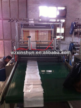 SHXJ -E full automatic T-shirt hot-sealing cold cutting bag making machine
