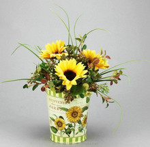 YELLOW SUNFLOWER ARRANGEMENT ON ROUND IRON PLANTER