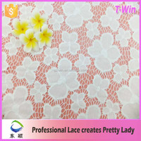 Fashion design good quality flower pattern latest Thailand lace fabric/nylon spandex hollow out lace fabric for women dress