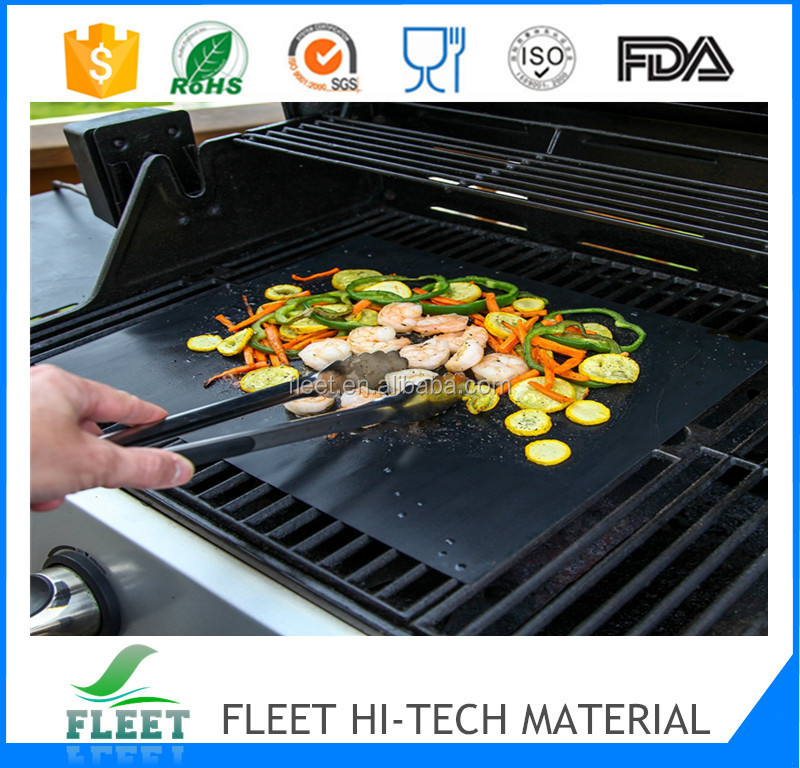 black teflon cooking sheet used as outdoor bbq tool