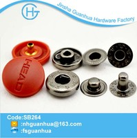 Red plastic cap snap button