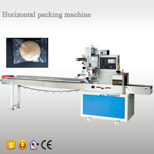 Foshan factory automatic pillow type plastic film food biscuit chocolate flow packing machine price 2 years warranty