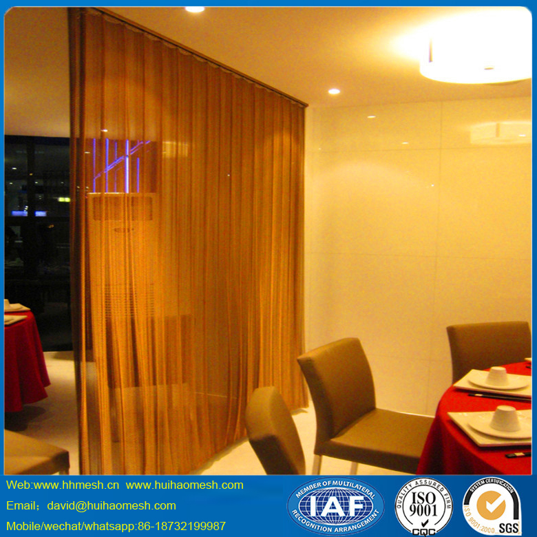 Metalic chain link curtain as decorative drapery