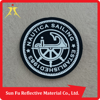 China Manufacturer suede label with injection silicon logo