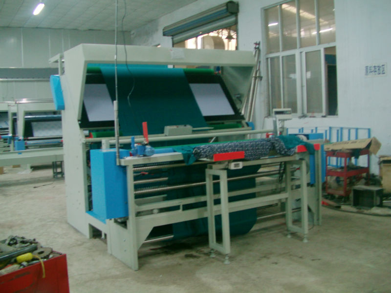 Knitting machines with inspection and rolling