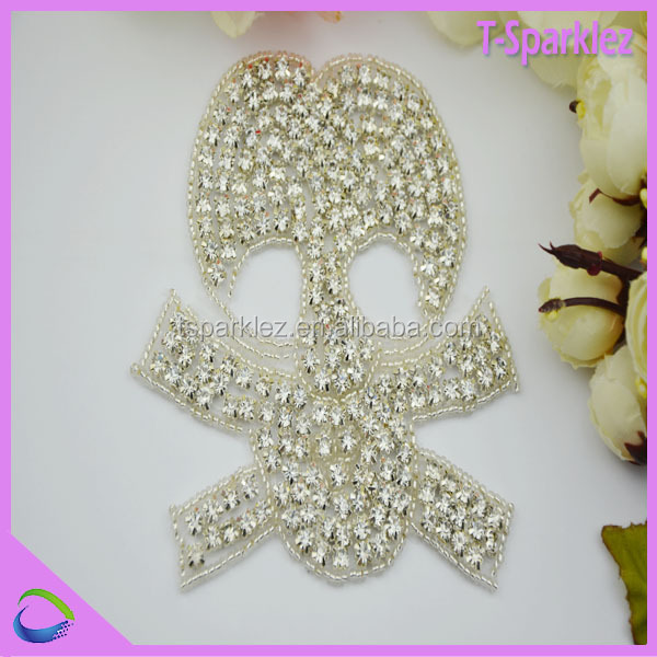 new fashion skull design hot fix stone applications for dresses wholesale