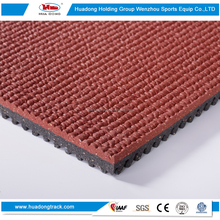 durable artificial rubberized running surface for track and field
