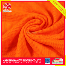 Hot selling 100%polyester fluorescent spun yarn knitted pique fabric for polo shirt