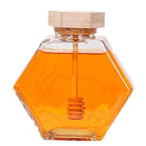 Hexagon glass honey storage jar with honey stick and wooden lid