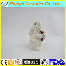 Super cute white ceramic rabbit holding flowers