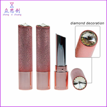 Custom luxury unique cute makeup empty plastic special round long slim lipstick tube with diamond decoration cover lid ZK69019C
