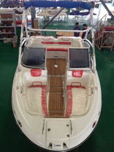 Fiberglass small boat with water ski and trailer
