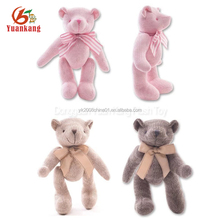 Cute knitted stuffed plush joint teddy bear in colorful sweater with movable arms and legs