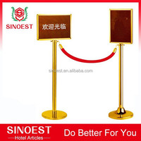 Gold event velvet rope barrier with sign board