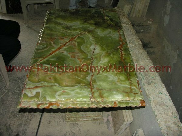 Natural color dark green onyx table