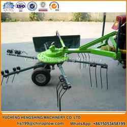 Tractor rake and tedder agricultural raker