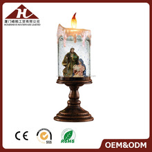 Religious candlestick snow globe with LED light