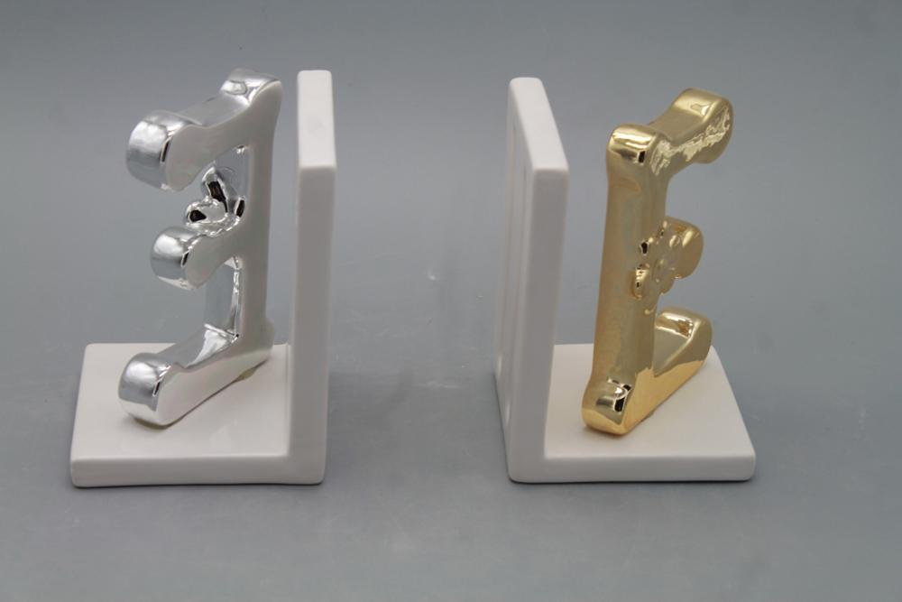 artificial ceramic modern bookends with golden or silver weapon style decor