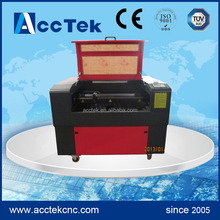co2 wood design laser cutter machine/ co2 laser engraving cutting machine price with ISO CE FDA certification