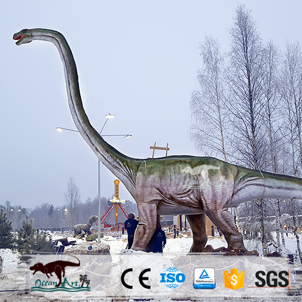 Amusement Park mechanical simulation dinosaur in the snow