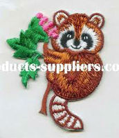 appliqued fabric embroidery patch squirrel motif