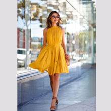 wholesale stock lot sleeveless women pleated dress yellow color Solid color ladies dress sale