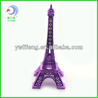 purple eiffel tower model of metal with strass