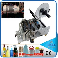 HIG Excellent economy round bottle semi automatic sticker labeling machine for small scale production