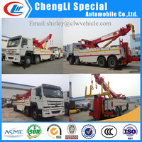 360 degree rotation Crane 30ton Lifting 20ton Sinotruk 12 wheel heavy duty wrecker tow truck for sale