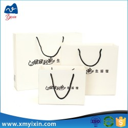 Wholesale white card polka dot paper bag log