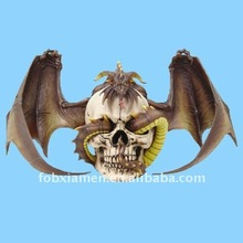 Polyresin decorative dragon with skull