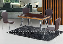 glass table and leather coated chair dining room set