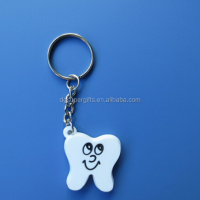 Cute design white tooth shape soft pvc key chains rings customized