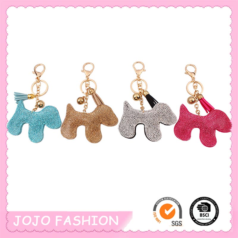 Fashion hot selling eco-friendly cute crystal dog sweet color PU leather suede tassel keychain for girls/