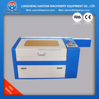Desktop co2 laser engraving machine for leather bracelets wood pen with rotary device manufature