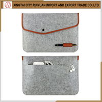 Portable dark grey felt laptop carrying case with leather edge