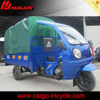 three wheel large cargo motorcycles with roof blue color